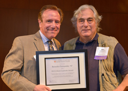 Asa Aarons, former consumer reporter for WCBS-TV, NY1 News, WNBC-TV and founder and co-creator of JustAskAsa website, presents Benedict Fernandez '87, with the Citizen Laureate Award.