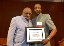 Emil Moxey, mentor emeritus at the Metropolitan New York Center is presented with the Heritage Award by Lear Matthews, a Metro Center mentor in community and human services and past recipient of the Altes Prize for Community Service.