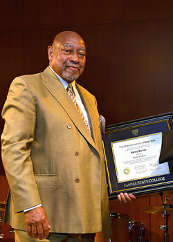 Kenny Barron '78 holds his Honorary Doctorate of Music. The degree is conferred by the SUNY Board of Trustees.