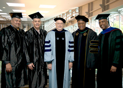 Student, alumni and faculty representatives for the BMI scholarship gathered at the 2013 Metropolitan Center graduation. From left to right they are: Student Lawrence H. Johnson, Keith Amparado '88, Professor Robert Carey, Professor David Fullard and Jay Marshall '06, '08. (Photo/Marty Heitner)