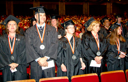 Members of Central New York Center's class of 2013 stand to be recognized. Images are by Michael J. Okoniewski of the 2013 Central New York Center graduation.