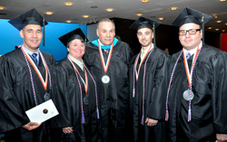 Red, white and blue tassels identify veterans and active members of the military graduating from the college. Seen here are Joseph Gutierrez, U.S. Navy, Catherine Liljequist, U.S.A.F, commencement speaker Robert Castelli '95, a U.S. Army veteran who served in Vietnam, Nicholas Bronner, U.S.A.F. and Karl Roman.