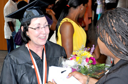 Newsday reporter Candice Norwood was on hand to interview student speaker Bernadine Bauser and several other students right after graduation.