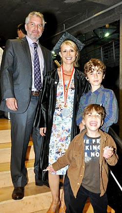 Graduate Melissa Stanley is surrounded by her husband Paul, at her left and sons Jephy and Zak