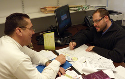 Staten Island student Thomas Taratko, at left, meets with his faculty Mentor Dov Fischer.