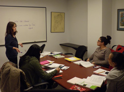 Staten Island faculty Mentor Ruth Losack meets with students in her linguistics course.