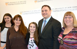 2014 recipient of the Chancellor's Award for Student Excellence Mark Rider is supported by daughter Claire, far left, wife name, daughter Lauren, and his mother Linda, at his right, at the at the ceremony honoring this year's winners. Photo/Empire State College