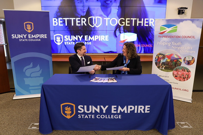 SUNY Empire State President Jim Malatras shaking hands with  Janine Stuchin, executive director of the Prevention Council.